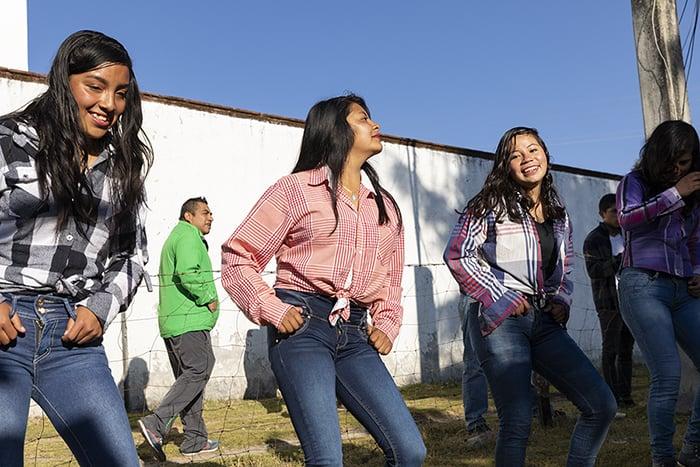 Teenagers of Macheros practive a dance.